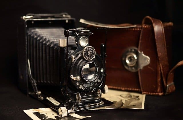 A silver camera on a table