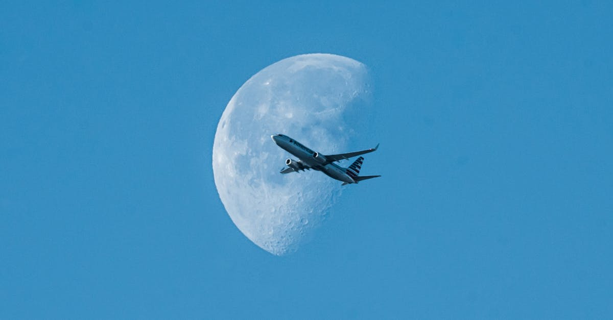 A large air plane flying in a clear blue sky