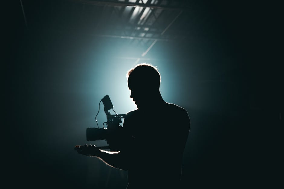A man that is standing in the dark