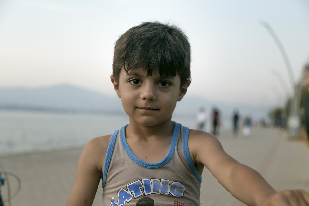 A young boy who is smiling at the camera